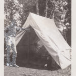 Man_leaning_agains_tent